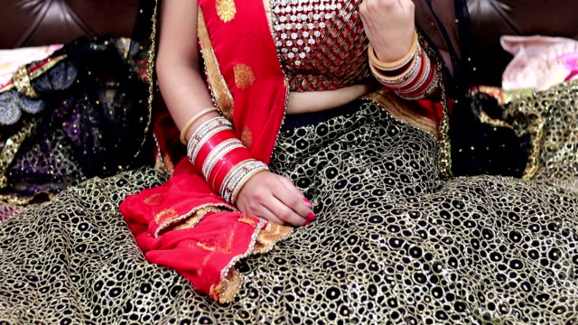 Smile portrait of sitting young traditional Indian bride in traditional wedding dress video