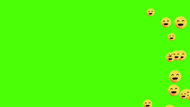 smile symbol icon animated come across the green screen - emoji video stock e b–roll