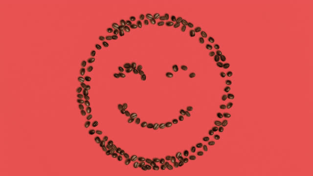 Smile Symbol Shaped coffee bean on red Background