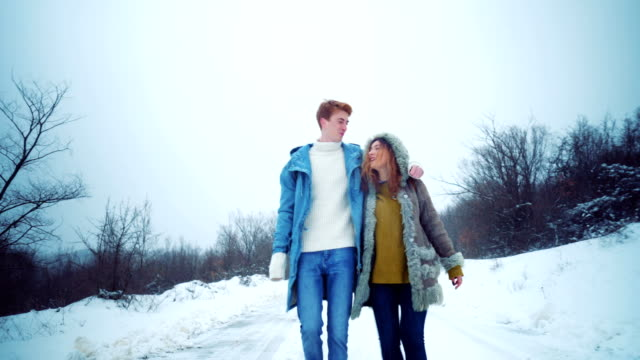 Smiled couple enjoying winter walk video