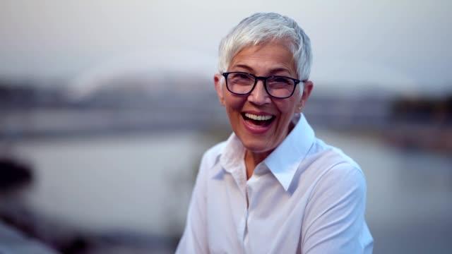 smiled senior woman looking at camera - sorriso aperto video stock e b–roll