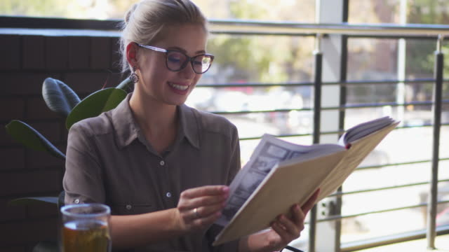 Smiley blond reading book video