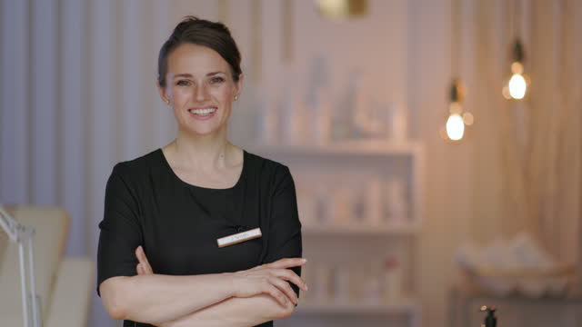 smiling 40 years old woman worker in modern beauty salon smiling 40 years old woman worker in modern beauty salon. beautician stock videos & royalty-free footage