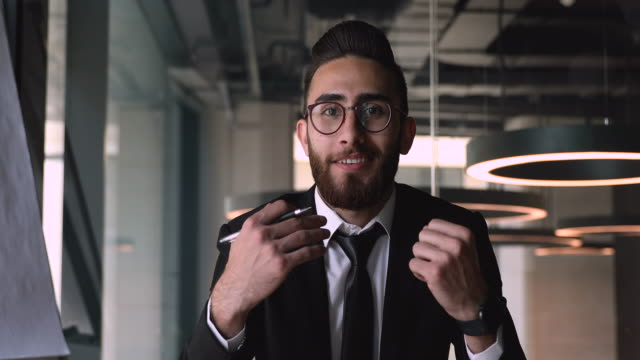 Smiling arabic businessman coach talk look at camera in office