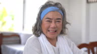 istock Smiling asian senior elderly woman looking at camera at home 1265652324