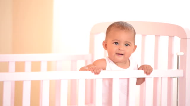 Smiling baby in her crib. video