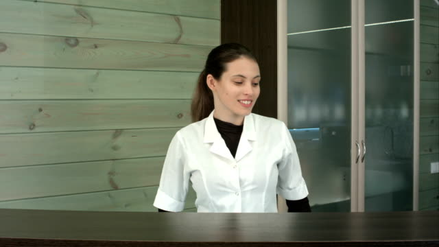 Smiling beauty salon manager at the reception desk video