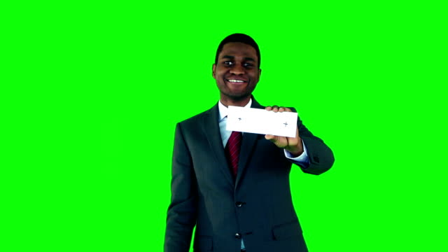 Smiling businessman showing cards video