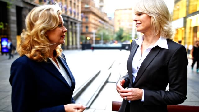 smiling businesswoman in the city of sydney
