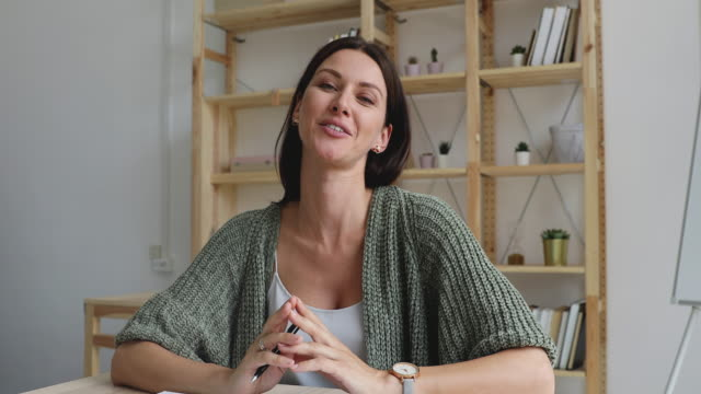 Smiling businesswoman talking to camera video calling for job interview