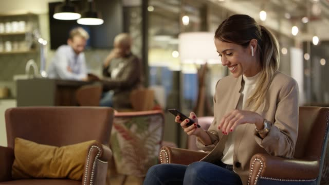 Smiling businesswoman using digital tablet Smiling businesswoman talking through smart phone at creative office. Dolly short of female entrepreneur is using cellphone in cafeteria. Professional is working late. bluetooth stock videos & royalty-free footage