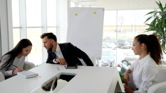 smiling candidate during job interview into large company in white and spacious office, dialog on job with secretary video