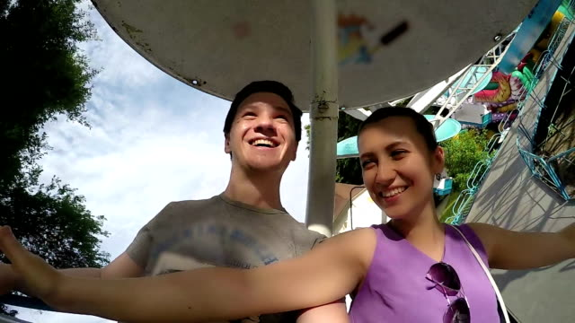 Smiling Couple on the Carousel video
