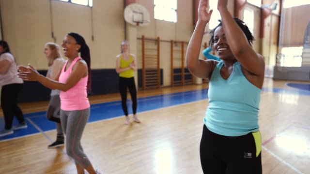 smiling, enthusiastic people cheering in dance class - body conscious stock videos & royalty-free footage