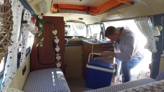 Smiling family getting into a camper van, shot on R3D Smiling family getting into a camper van, shot on R3D rv interior stock videos & royalty-free footage