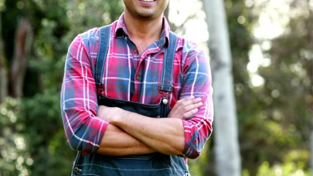 Smiling farmer standing video