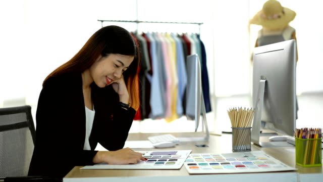 Smiling Female Designer Looking At Fabric Swatch In The Office 4K Happiness Female Designer Choosing Color Sample From Fabric Swatch For Her Product In The Office fabric swatch stock videos & royalty-free footage