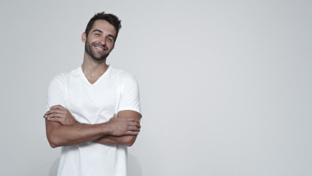 smiling handsome guy - maglietta bianca video stock e b–roll