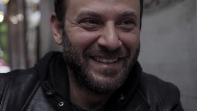 smiling happy man - solo un uomo giovane video stock e b–roll