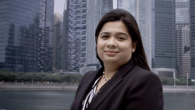Smiling Indian Businesswoman Standing on Bridge video