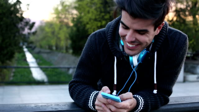 Smiling man texting in the city video