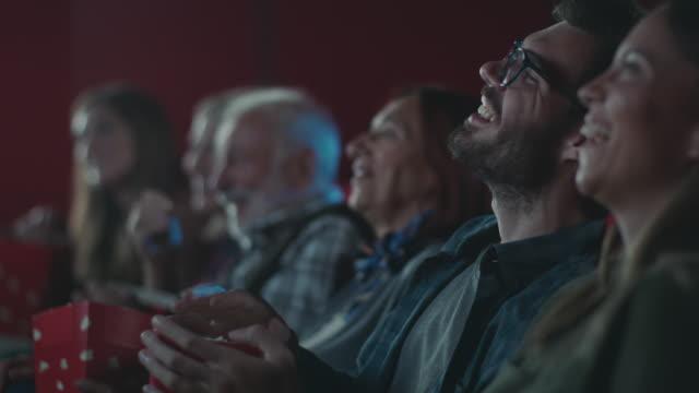 Smiling man watching movie at cinema