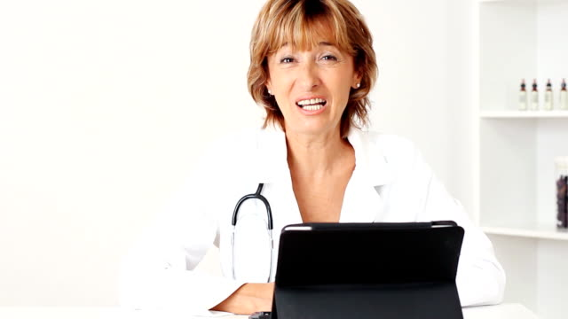 Smiling mature female doctor video