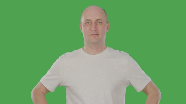 Smiling middle aged agree man nodding head. Alpha channel, keyed green screen Smiling middle aged agree man in casual t-shirt nodding head, front view. Alphachannel, keyed green screen arms akimbo stock videos & royalty-free footage