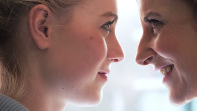 Smiling mother with  daughter. Close Up Of Mother And Daughter Faces Together
