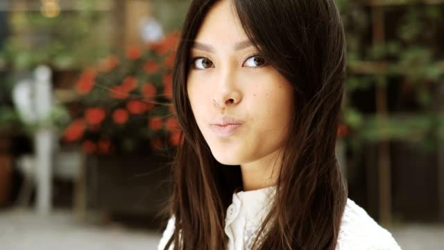 stockvideo's en b-roll-footage met lachend portret van aziatische vrouw - oost aziatische cultuur