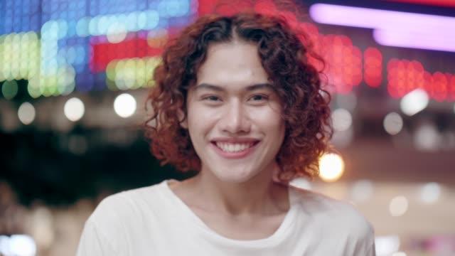 Smiling portrait of Cross Dressing Man wearing like woman stock video video