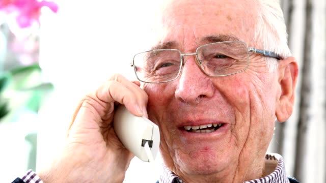 Smiling Senior Man Talking On Telephone At Home video