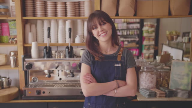 Smiling Small Business Owner Standing Arms Crossed In Coffee Store video