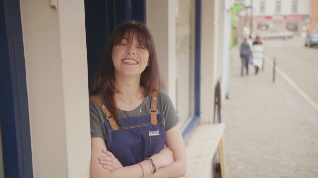 Smiling Small Business Owner Standing Arms Crossed Outside Store video