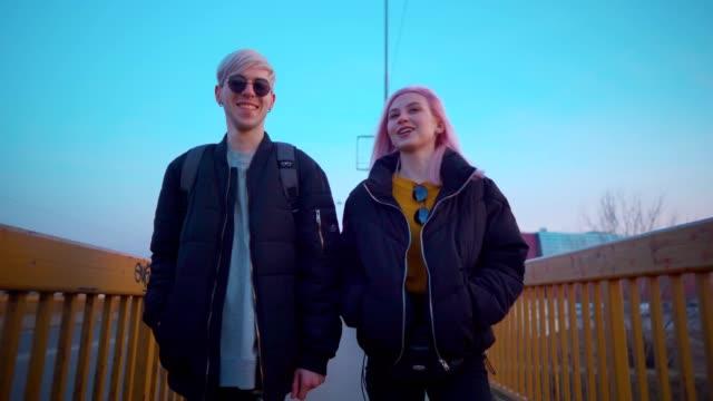 smiling teen couple in a walk - поколение z стоковые видео и кадры b-roll