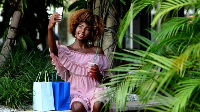 Smiling urban woman using mobile phone