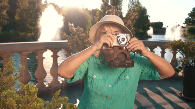 Smiling woman holds camera. video