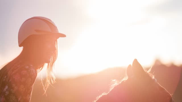 Smiling woman horseback riding video
