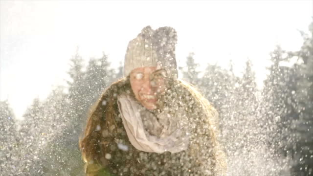 Smiling Woman Playing with Snow Beautiful Winter Sun Outdoors video