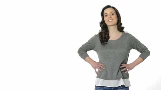 Smiling woman showing copy space video