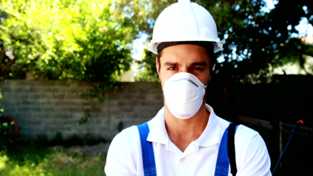 Smiling worker standing with arms crossed video