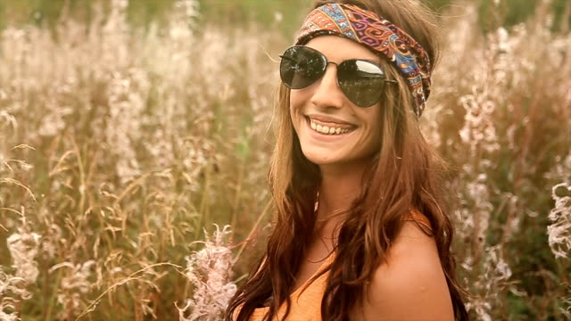 smiling young hippie women in the field,portrait