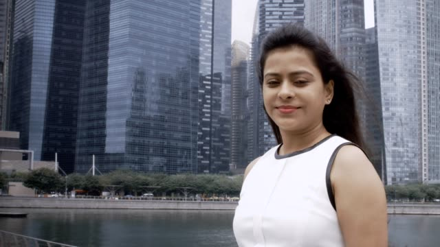 Smiling Young Indian Businesswoman on Bridge video