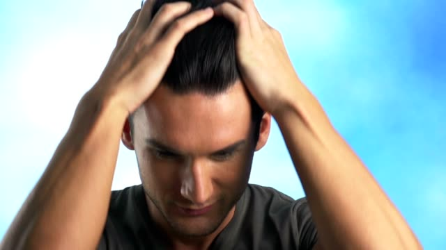 Smiling young man, hands in hair video
