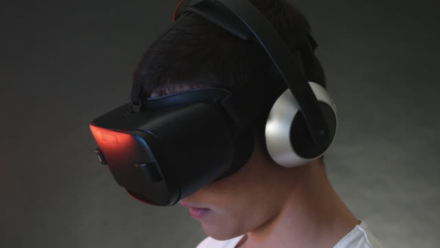 Smiling Young Man Wearing VR Headset And Experiencing Virtual Reality video