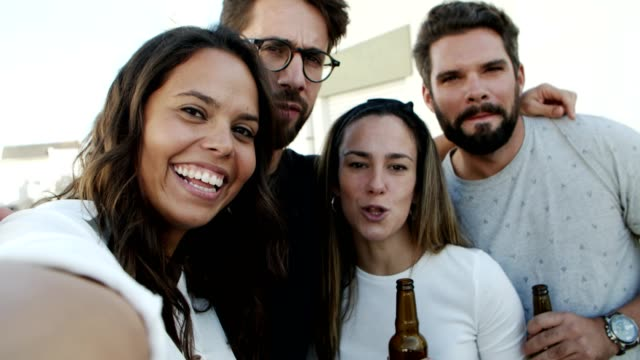smiling young people posing for selfie - happy hour video stock e b–roll