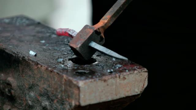smith is forging  steel smith is forging  steel wrought iron stock videos & royalty-free footage