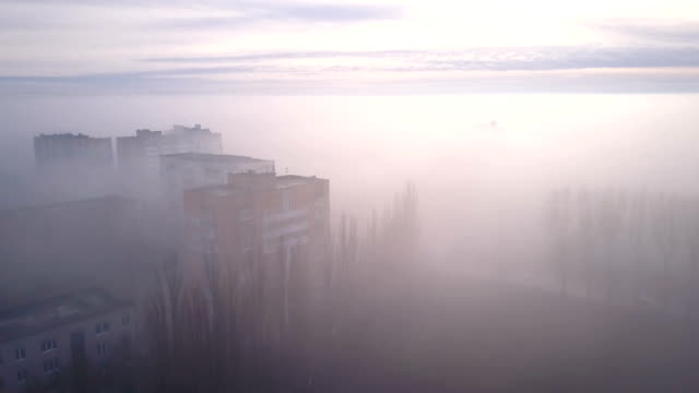 smog or fog in the city. apocalypse city in fog aerial view. - смог над городом стоковые видео и кадры b-roll