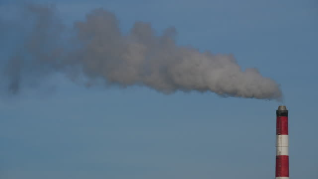 Smoke and air pollution from a incinerator chimney near Caen, Normandy, France. Smoke and air pollution from a incinerator chimney near Caen, Normandy, France. caen stock videos & royalty-free footage