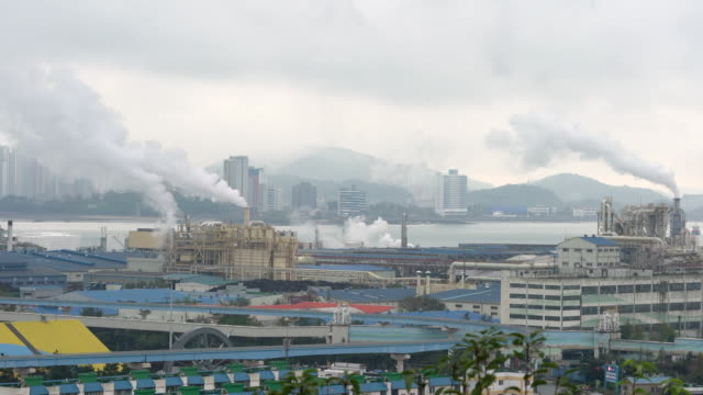 smoke and pollution from industrial chimneys in incheon port south korea - corea del sud video stock e b–roll
